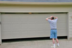 A Man stand in front of garage door